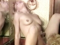 Two blonde girls are talking to each other in the bathroom. A little later one of them is licking the tits of the other one. Then the first girl sits down on top of the sink, spreads her legs wide to have her pussy licked by the other one.