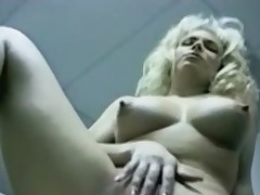 Masturbating golden-haired in retro office porn video