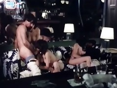 Two retro girls are having lesbian sex on the couch when they are joined by two guys and another girl. Soon enough they lose attetion for each other and go for the dicks that are offered to them. To top it all a third girl joins the fuckfest too!