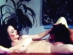 A woman is laying naked on a bed. At the other end of the room a guy is undressing. He joins her on the bed and gives her a massage, squeezing her tits. Then he licks her hairy pussy before she climbs on top of him for a fuck.