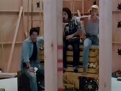 Three guys at a building site are trying to get the attention of a blond girl. One of 'em kisses her and she gives him a blow job. Later on they are joined by the other two men and they all fuck her in turn.