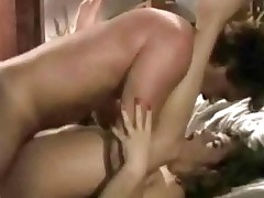 A guy is sitting at a table in a bar when a topless girl joins him. A little later they are on a bed were the girl is giving the guy a blow job. Then he fucks the girl in various positions.