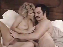Man with a mustache bangs a hot golden-haired girl