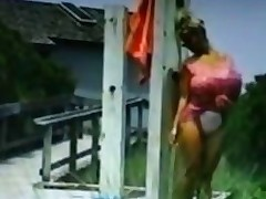 Huge jugs blonde chick washes herself outside