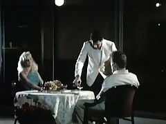 A couple is sitting at a restaurant table where a waiter is serving them wine. The guy admits this guy likes to eat pussy and the girl lifts up her skirt, showing her crotch. A little later the both of them fuck in various positions.
