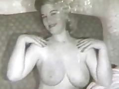 A blonde girl with large tits is sitting on a sofa, showing her naked body off to the camera which zooms in on her giant boobs. In the next scene a guy is trying to seduce a woman. She objects but he manages to undress her completely.