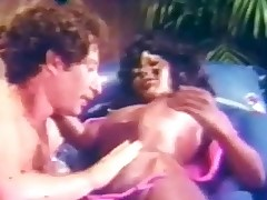 A black hotty is laying naked on an air bed while a white guy is licking her whole body, especially her hard nipples. A little later this chab is laying on his back with her on top of him, fucking away until this chab comes on her stomach.