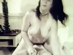 Two young, naked girls are on a bed. One of them lays down and spreads her legs while the other covers a large dildo with lubricant. Just when they are fucking each other a guy enters. He licks one of the girls while the other sucks his dick.