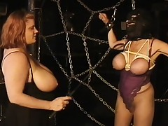 Massive tit ladies play mistress and slave in two scenes of playful torture