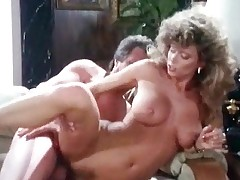A couple is in a living room arguing with each other. Suddenly she lifts her dress, showing her hairy pussy. He starts licking it. A little later the both of them are naked. The girl leans over the couch so that guy can fuck her from behind.