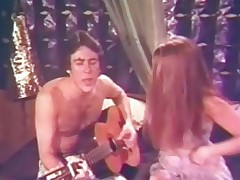 A guy with a guitar is sitting on the couch singing to his girlfriend. This babe takes off her clothes, pulls his pants down and sucks his cock. The proceed in 69 position until the guy fucks her hairy pussy.